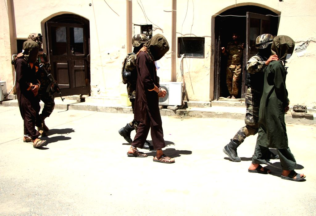 JALALABAD, May 23, 2018 - Afghan security forces members escort arrested suspected militants in Jalalabad city, the capital of Nangarhar province, Afghanistan, May 23, 2018. Afghan security personnel ...