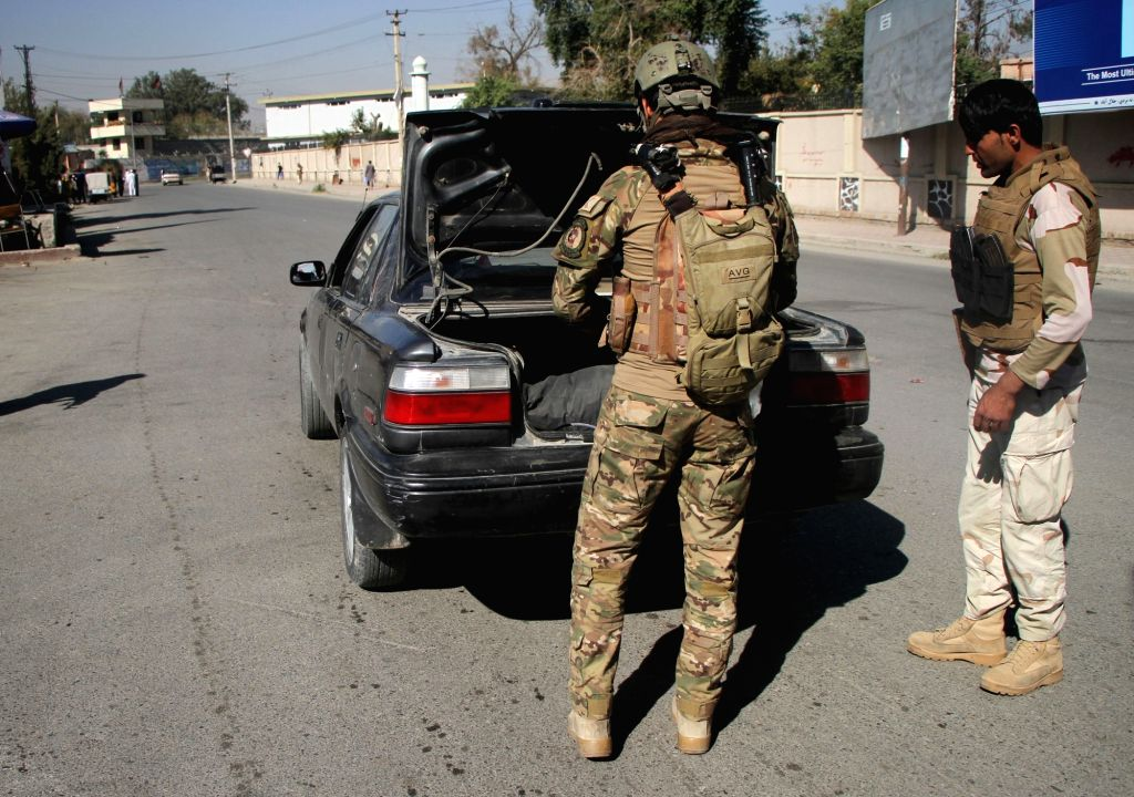 JALALABAD, Nov. 4, 2018 - Afghan Special Force members check a car at a security checkpoint on the road leading to Nazyan district in Nangarhar province, Afghanistan, Nov. 4, 2018. Up to 18 militants ...