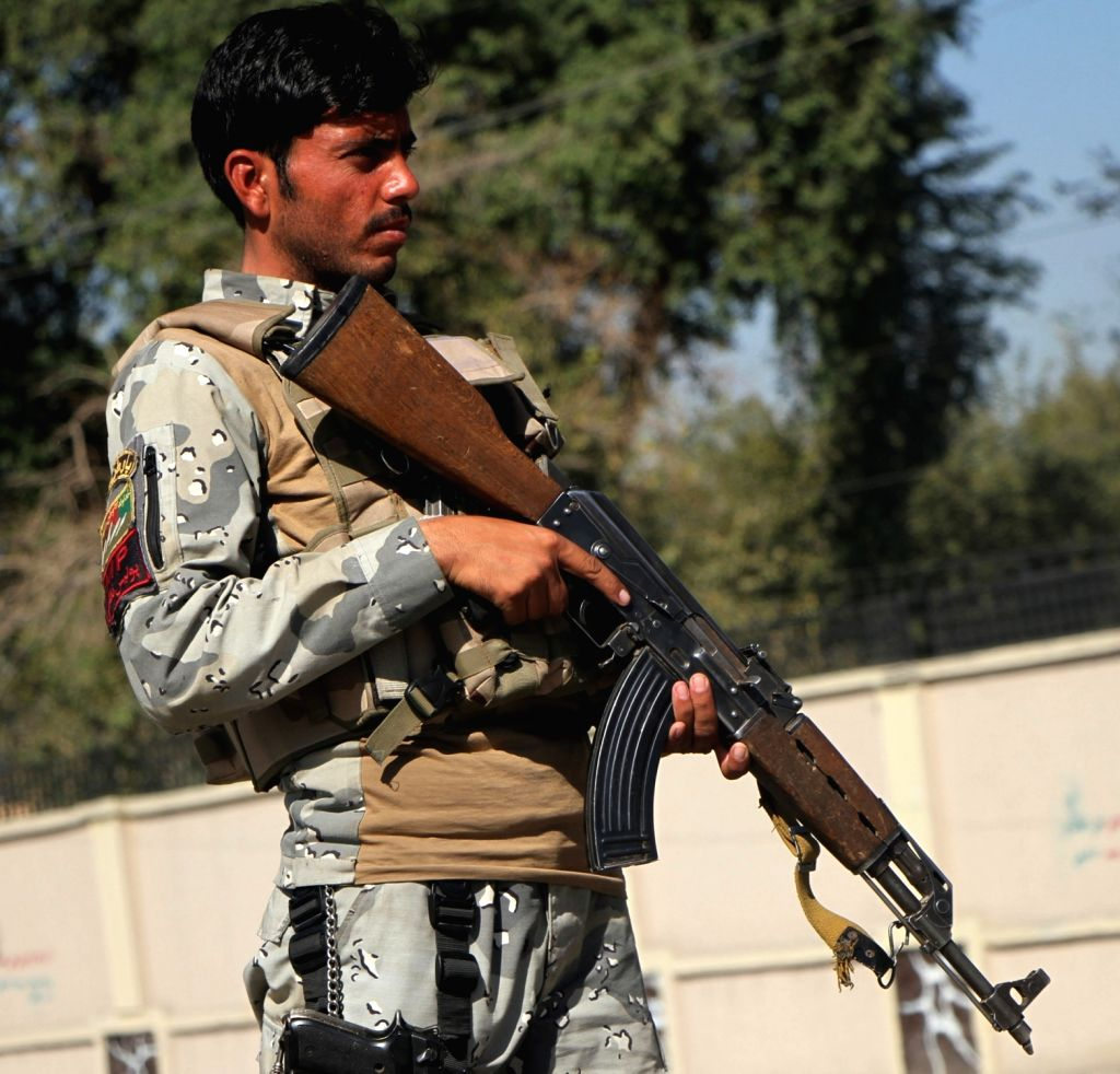 JALALABAD, Nov. 4, 2018 - An Afghan Special Force member stands guard at a security checkpoint on the road leading to Nazyan district in Nangarhar province, Afghanistan, Nov. 4, 2018. Up to 18 ...