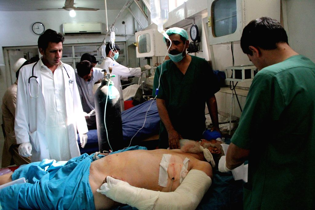 JALALABAD, Oct. 20, 2016 - An injured man receives medical treatment at a local hospital after a blast in Batikot district of Nangarhar Province, Afghanistan, Oct. 20, 2016. At least 11 people, all ...