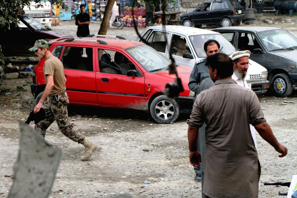JALALABAD, Oct. 8, 2016 - Afghan security force members inspect the site of a suicide attack in Jalalabad, Nangarhar province, Afghanistan, Oct. 8, 2016. One person was killed and four others injured ...