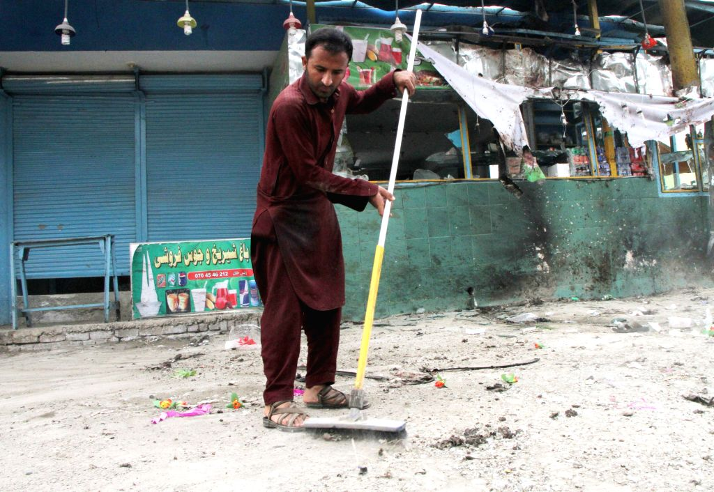 JALALABAD, Oct. 8, 2016 - An Afghan cleans the site of a suicide attack in Jalalabad, Afghanistan, Oct. 8, 2016. One person was killed and four others injured as a suicide attacker targeted a ...
