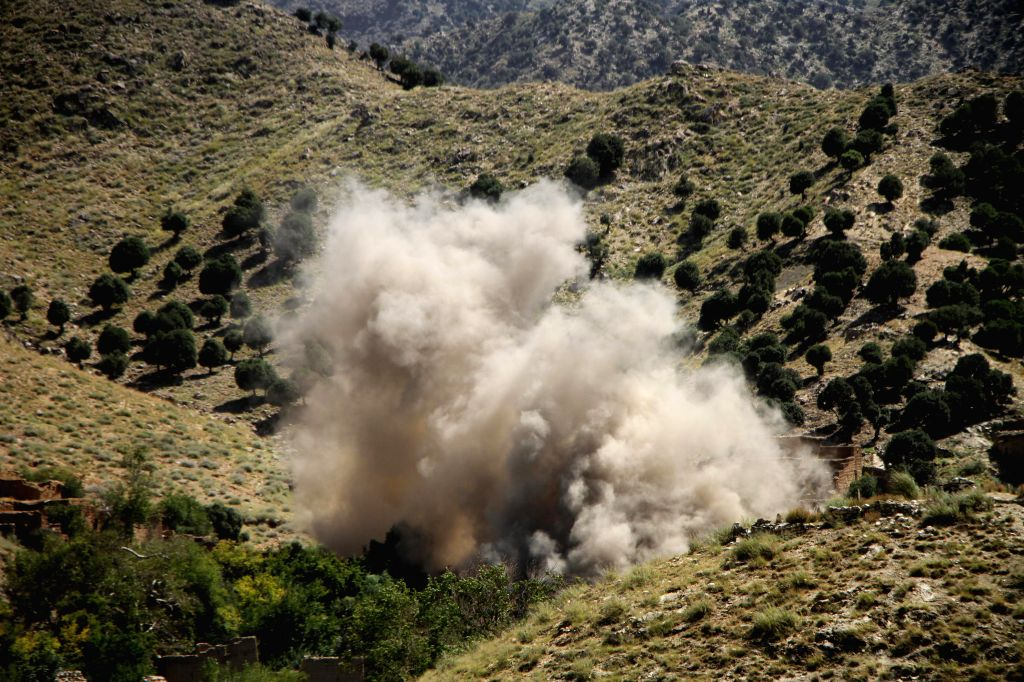 JALALABAD, Sept. 17, 2019 (Xinhua) -- Photo taken on Sept. 16, 2019 shows smoke rising from an ammunition depot during a military operation against Islamic State (IS) in Achin district of eastern Nangarhar province, Afghanistan. (Photo by Saifurahman