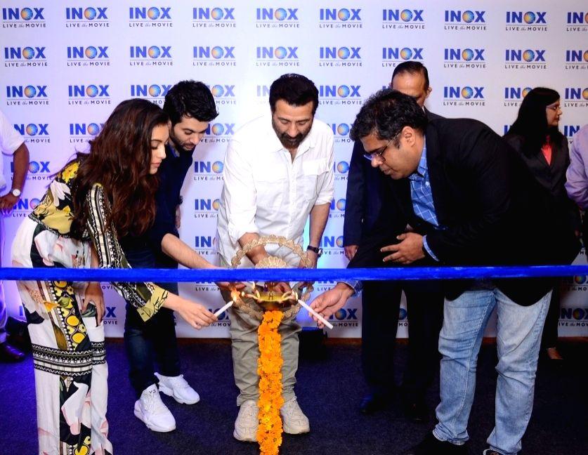 Jalandhar: Actors Sunny Deol, Karan Deol and Sahher Bambba at the launch of a cinema hall in Jalandhar on Sep 14, 2019. (Photo: IANS) - Sunny Deol, Karan Deol and Sahher Bambba