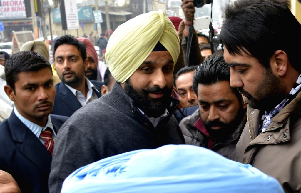 Punjab Minister Bikram Singh Majithia arrives to appear before Enforcement Directorate(ED) in connection with his alleged involvement in a drug racket in Jalandhar on Dec 26, 2014.