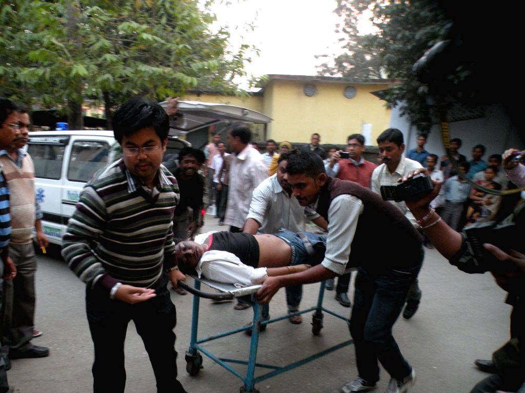 A student injured in a school bus accident being rushed to a hospital for treatment in Jalpaiguri of West Bengal on Feb 23, 2015. Reportedly four students were killed and many others ...