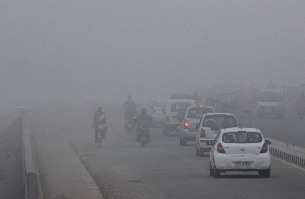 A blanket of dense fog covers Jammu on Jan 5, 2015.