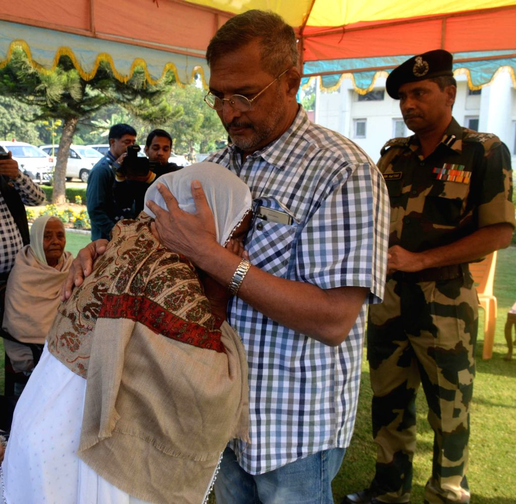 Jammu: Actor Nana Patekar meets family members of martyr who laid their lives while saving the nation in cross border firing at BSF Headquarters in Jammu on Nov 16, 2016. - Nana Patekar