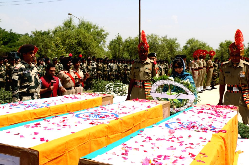 Jammu and Kashmir Chief Minister Mehbooba Mufti pays tribute to BSF soldiers who were killed when their convoy was attacked by Hizb-ul-Mujhadeen militants in Srinagar on June 4, 2016. - Mehbooba Mufti