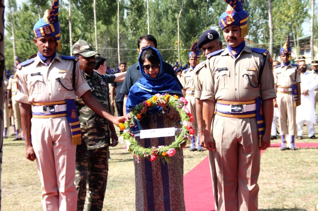Jammu and Kashmir Chief Minister Mehbooba Mufti lays wreath at the coffins of CRPF martyrs who were killed in June 25 Pampore militant attack; in Srinagar on June 26, 2016. - Mehbooba Mufti