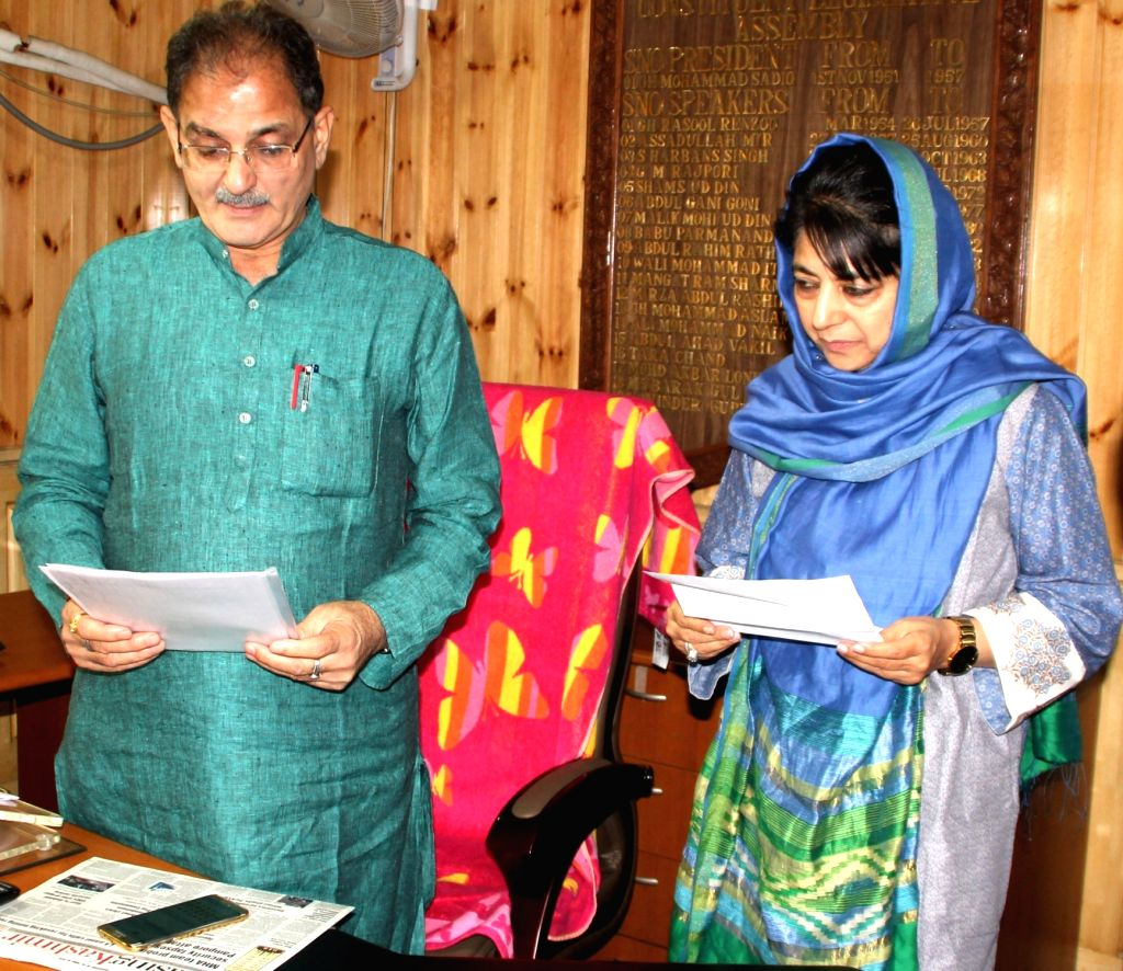 Jammu and Kashmir Chief Minister Mehbooba Mufti takes oath as  a member of the state legislative assembly in Srinagar, on June 30, 2016. Also seen speaker of the assembly Kavinder Gupta. - Mehbooba Mufti and Kavinder Gupta
