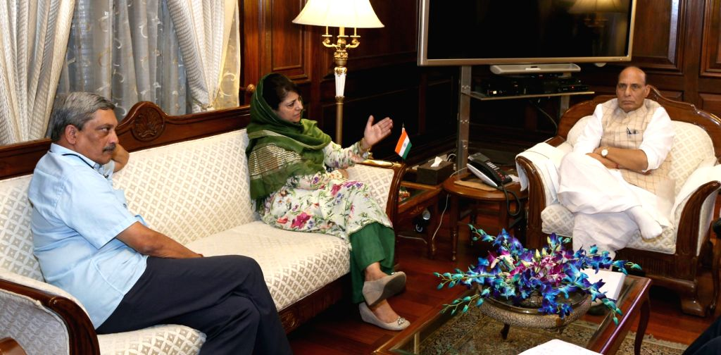 Jammu and Kashmir Chief Minister Mehbooba Mufti calls on the Union Home Minister Rajnath Singh in New Delhi, on Aug 8, 2016. Also seen Union Minister for Defence Manohar Parrikar. - Mehbooba Mufti and Rajnath Singh
