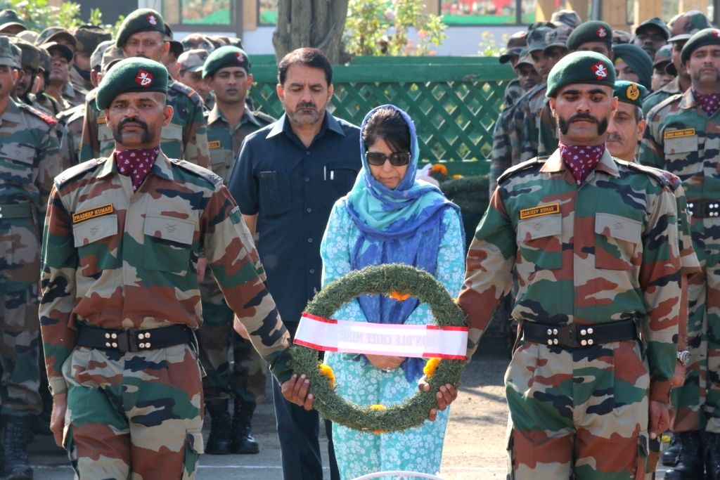 Jammu and Kashmir Chief Minister Mehbooba Mufti lays wreath at the mortal remains of martyrs of Uri terror attack, in Srinagar on Sept 19, 2016. - Mehbooba Mufti