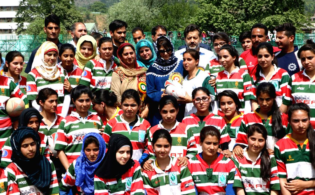 Jammu and Kashmir Chief Minister Mehbooba Mufti with with deaf and dumb girl football and basket ball players during an event organised by Jammu and Kashmir Sports Council at SRTC Ground in ... - Mehbooba Mufti