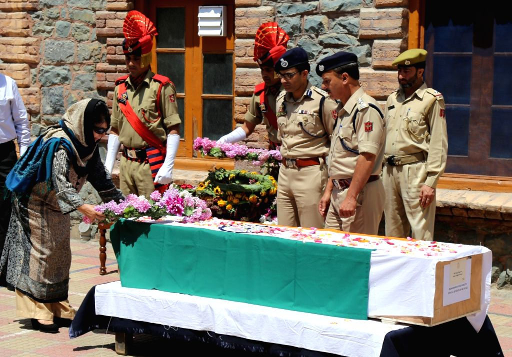 Jammu and Kashmir Chief Minister Mehbooba Mufti pays tribute to Deputy Superintendent Mohammad Ayub Pandit, who was lynched outside a mosque in Srinagar on Jume 23, 2017. The battered body ... - Mehbooba Mufti