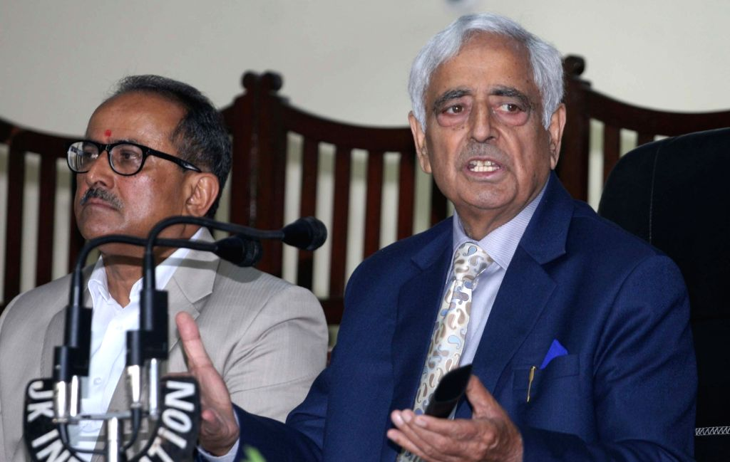 Jammu and Kashmir Chief Minister Mufti Mohammad Sayeed and Deputy Chief Minister Nirmal Kumar Singh during a press conference in Jammu on Nov 13, 2015. - Mufti Mohammad Sayeed and Nirmal Kumar Singh