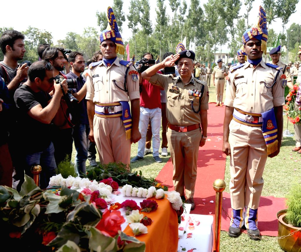 Jammu and Kashmir Director General of Police (DGP) SP Vaid pays tribute to a Central Reserve Police Force (CRPF) officer who was killed in a militant attack in Srinagar, on June 25, 2017.