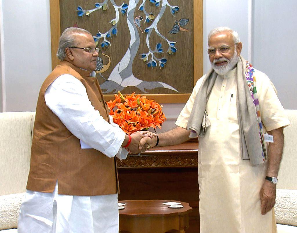 Jammu and Kashmir Governor Satya Pal Malik meets Prime Minister Narendra Modi, in New Delhi on June 1, 2019. - Narendra Modi and Malik
