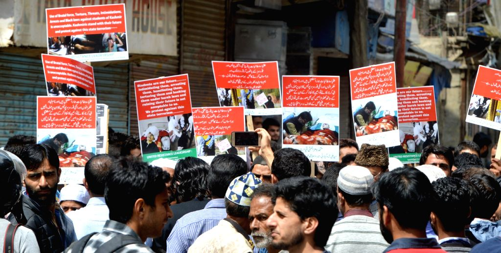 Jammu and Kashmir Liberation Front (JKLF) activists participate in a protest march against recent attack on students, in Srinagar on April 21, 2017.