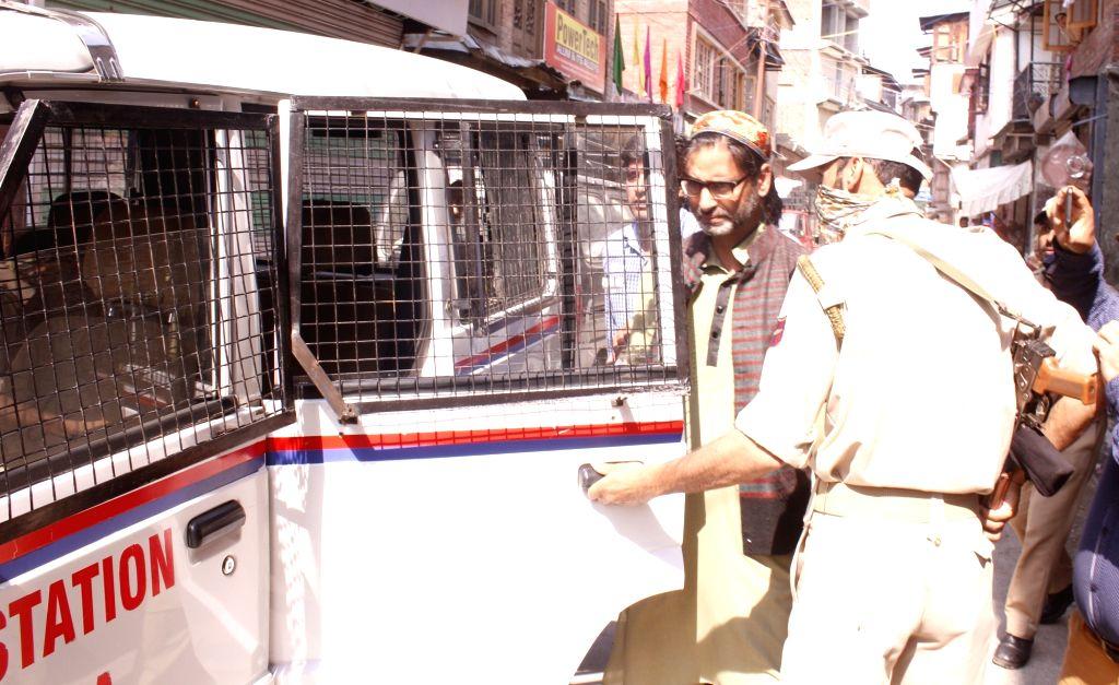 Jammu and Kashmir Liberation Front (JKLF) chief Yasin Malik being taken away by police in Srinagar on June 24, 2017. - Malik