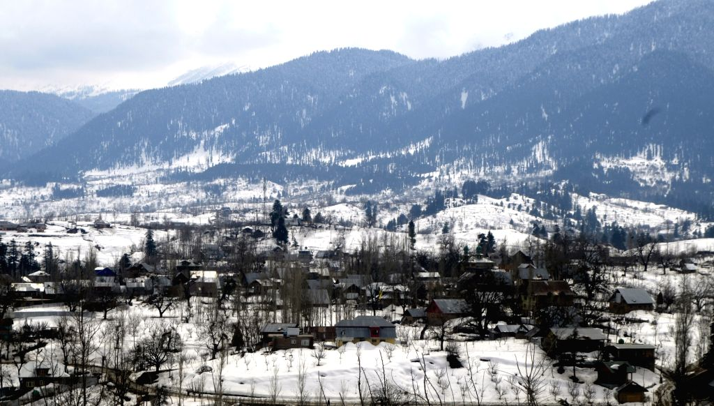 Jammu and Kashmir's Baramulla receives fresh snowfall, on March 8, 2019.