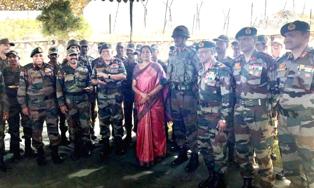 Jammu and Kashmir: Union Minister for Defence Nirmala Sitharaman interacts with the troops at one of the forward area posts, in Jammu and Kashmir on Sept 29, 2017. Also seen Chief of Army Staff ...