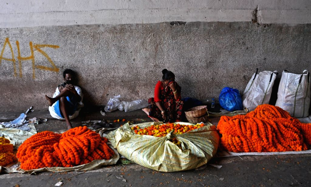 Jammu, April 14 (IANS) It is the peak marigold flower harvesting season in J&K, but instead of taking the yield of the cash crop to Jammu markets, farmers are wasting it by throwing it into canals.