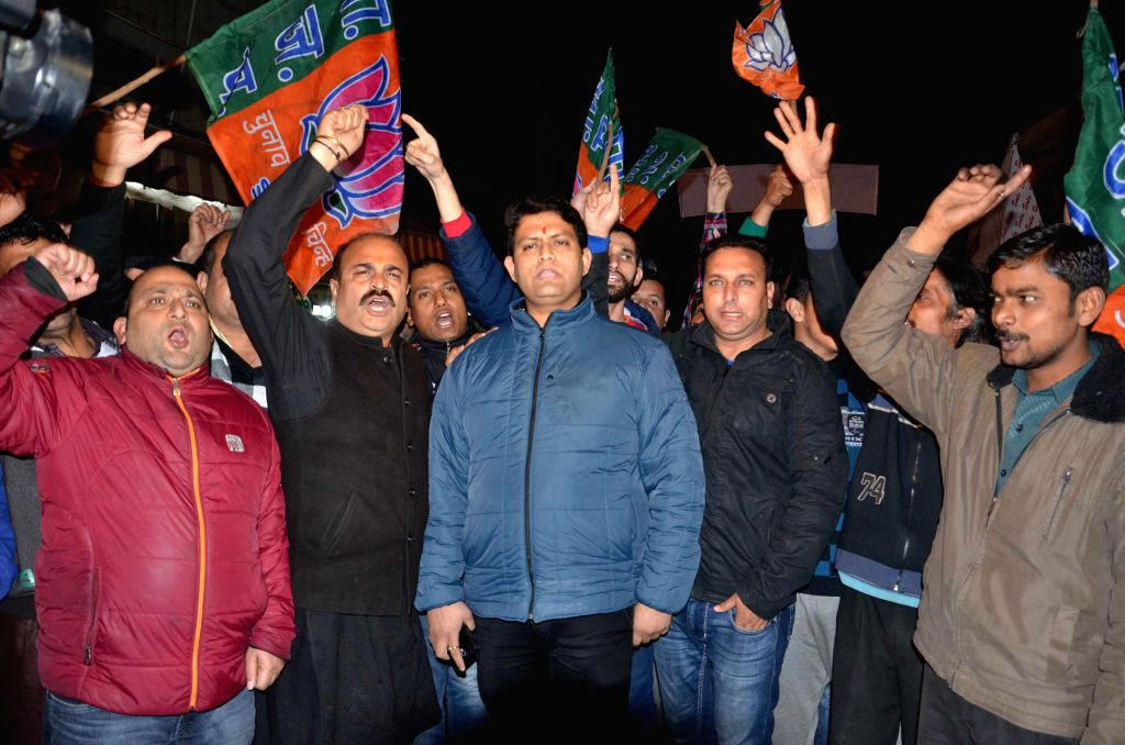 BJP workers stage a protest against Jammu and Kashmir Government for releasing separatist leader Masarat Alam from preventive detention after more than four years in Jammu on March 7, 2015.