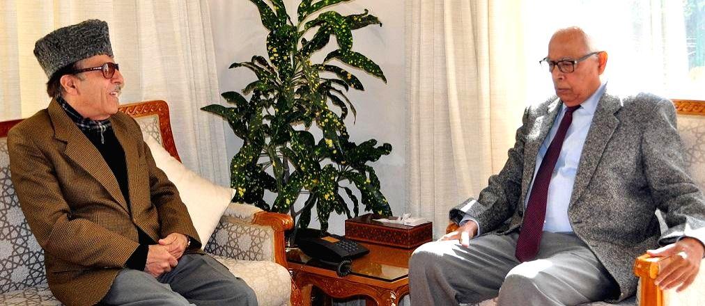 Congress leader Saifuddin Soz calls on Jammu and Kashmir Governor NN Vohra  at the Raj Bhavan in Jammu on Dec 31, 2014.