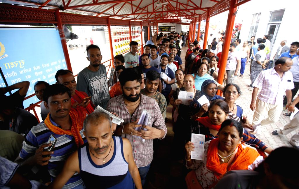 Jammu: Devotees at a Bhagwati Nagar base camp after the Amarnath Yatra was suspended with no pilgrim allowed to move towards the Kashmir Valley from Jammu due to a separatist-called protest shutdown, on July 13, 2019. (Photo: IANS)