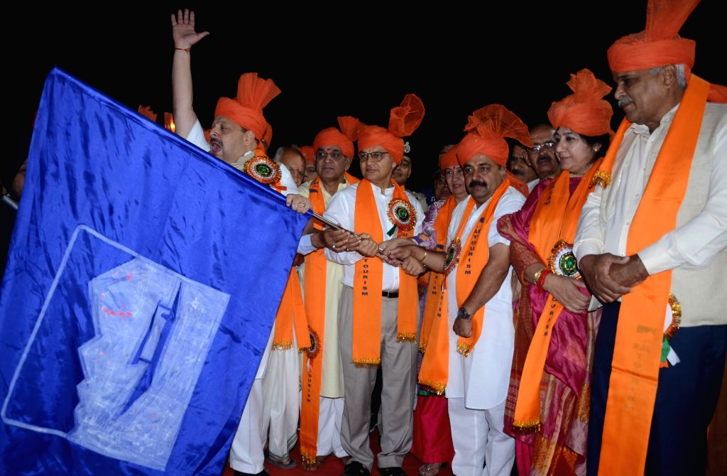 Jammu: Jammu and Kashmir Governor Satyapal Malik's Advisor KK Sharma flags off the first batch of Amarnath Yatris to begin this year's annual Hindu pilgrimage to the Himalayan cave shrine in Jammu, on June 30, 2019. The 45-day long Amarnath Yatra wil