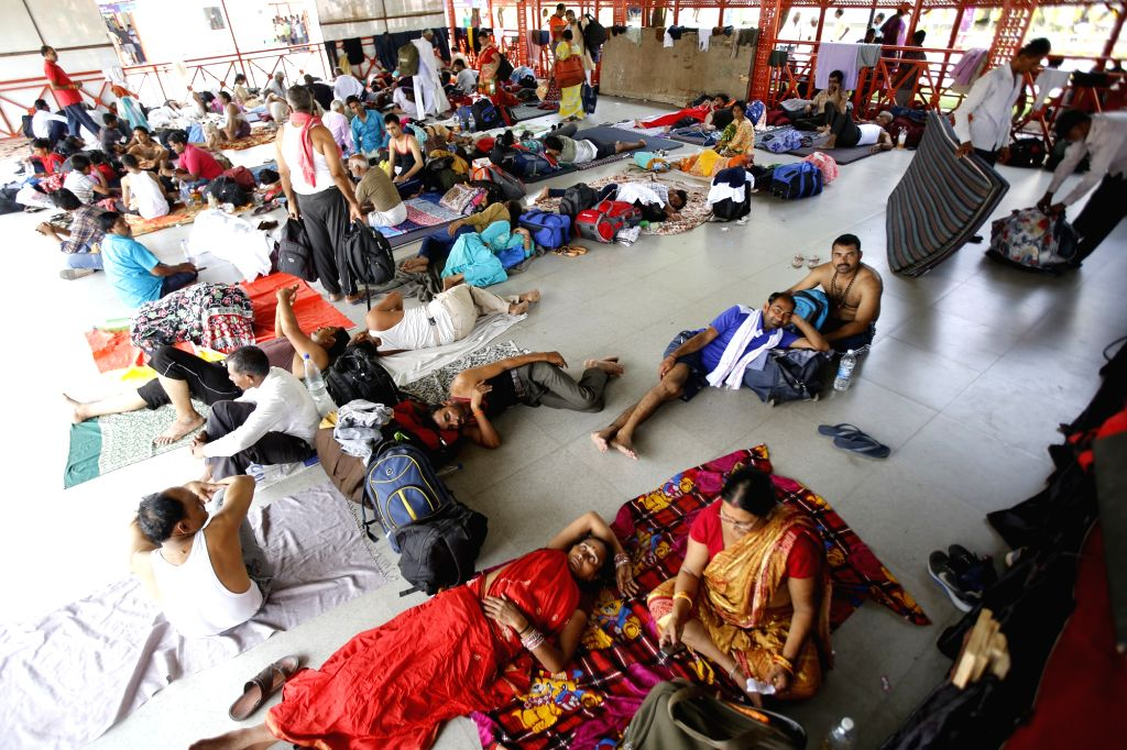 Jammu: Pilgrims at a base camp after the annual Amarnath Yatra was suspended, in Jammu on July 8, 2019. Restrictions were imposed in parts of the Srinagar city and other places in the valley on Monday to prevent separatist-called protests on the deat