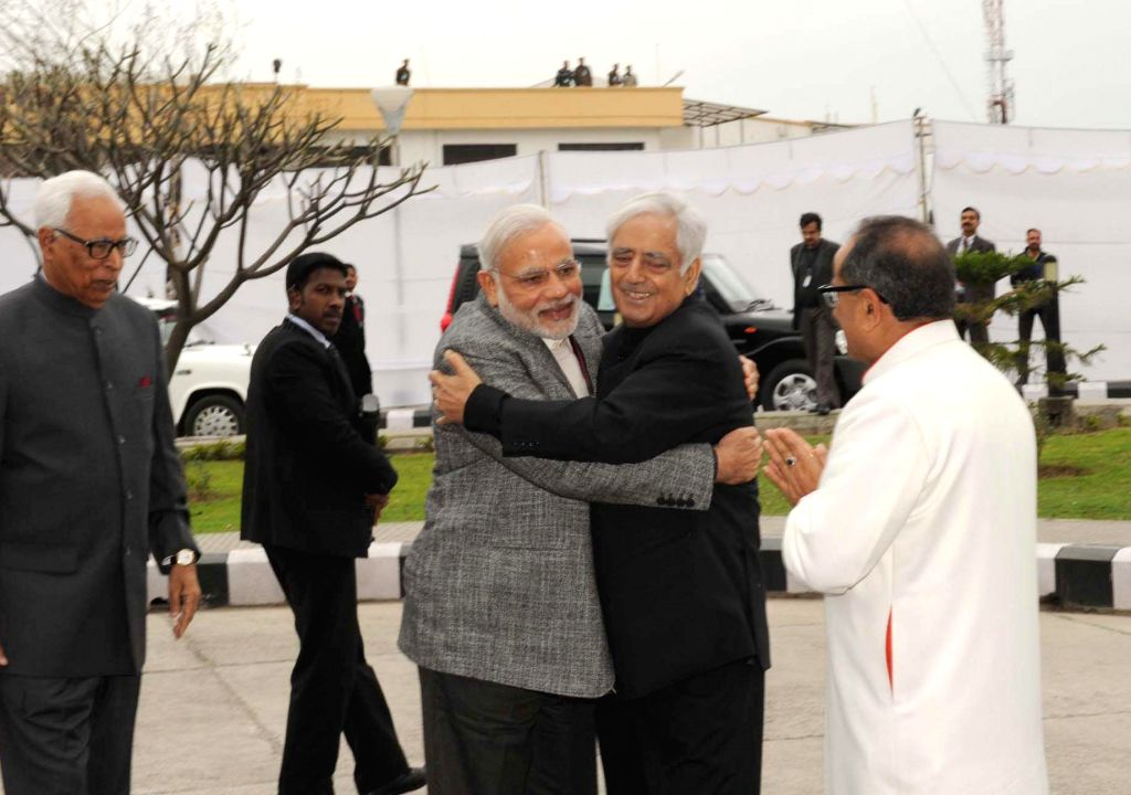 Prime Minister Narendra Modi arrives at the swearing-in ceremony of PDP patron Mufti Mohammad Sayeed as Jammu and Kashmir Chief Minister, at Jammu University, on March 1, 2015. Also seen the ... - Narendra Modi