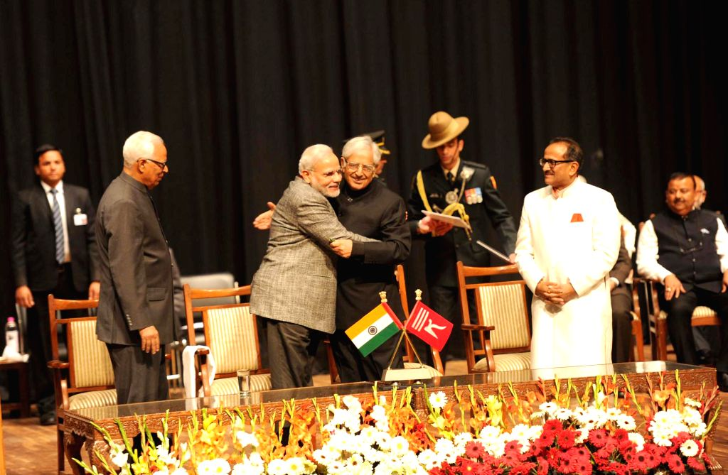 Prime Minister Narendra Modi congratulates PDP patron Mufti Mohammad Sayeed after swearing-in as Jammu and Kashmir Chief Minister, at Jammu University, in Jammu and Kashmir on March 1, 2015. ... - Narendra Modi