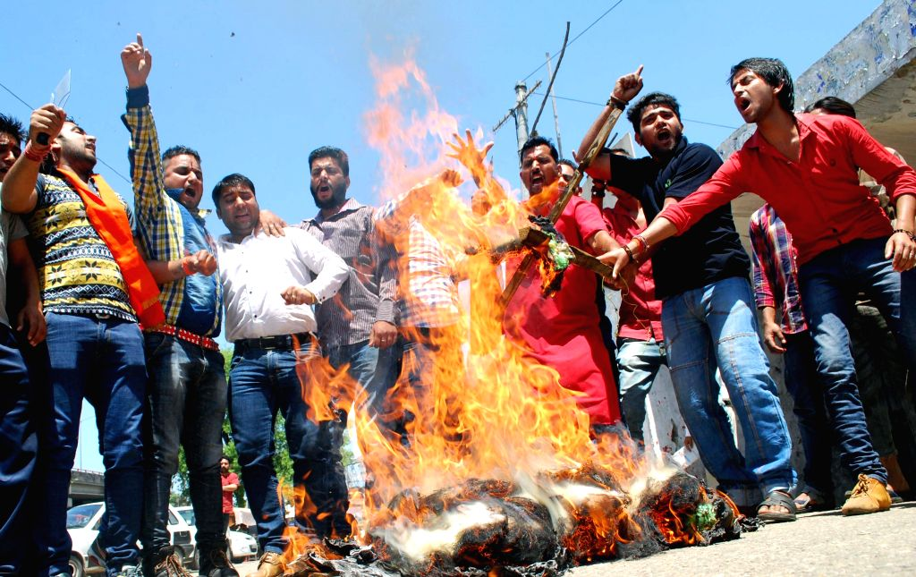 The activists of Bajrang Dal stage a demonstration against the waving of Pakistani flag during a rally by separatists in South Kashmir and demanded the arrest of Hurriyat leader Syed Ali Shah ...