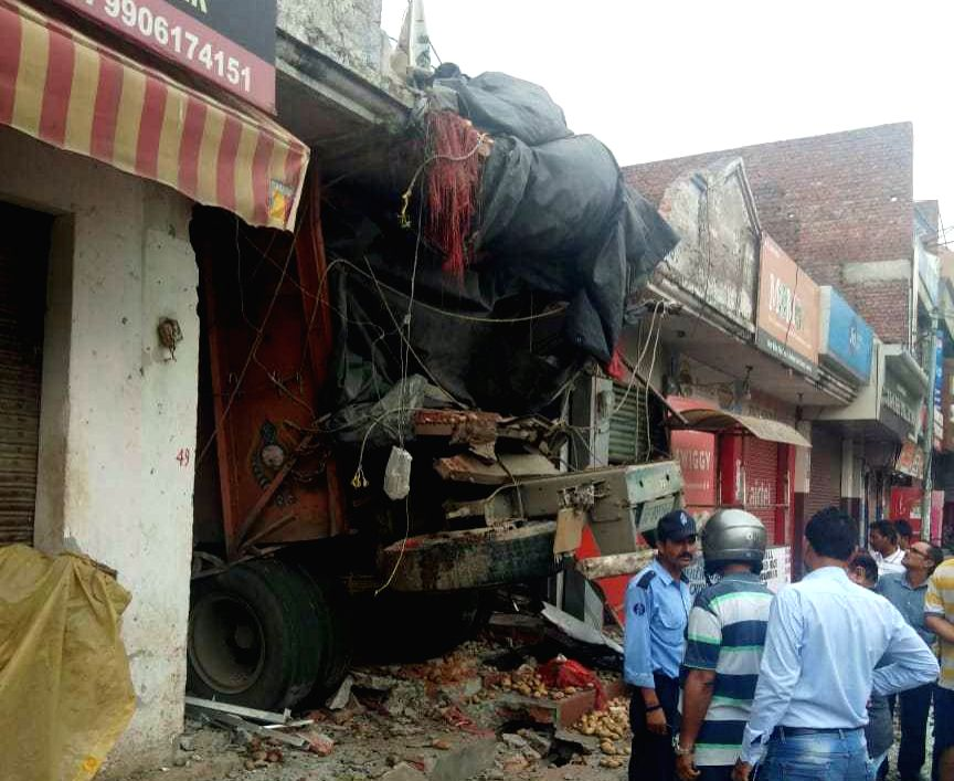 Jammu: The site where a truck loaded with potatoes rammed into an ATM booth in Jammu, on July 17, 2019. According to the police, the driver and the helper of the truck were killed while an ATM guard was injured in this accident. (Photo: IANS)