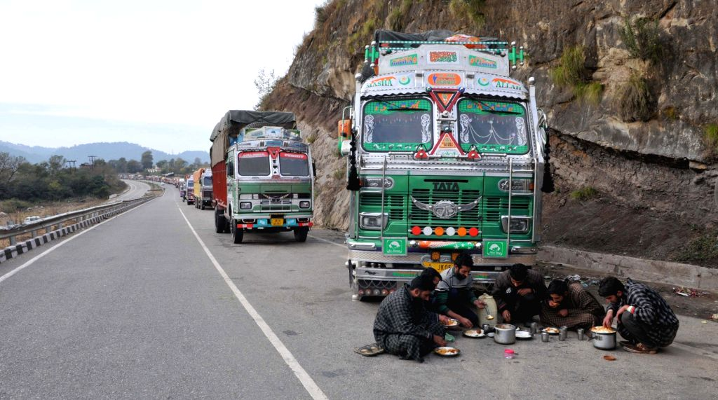 Jammu: Trucks stranded on Jammu-Srinagar national highway as widespread rain along the highway triggered the shooting stones at some places on March 2, 2018. (Photo: IANS)