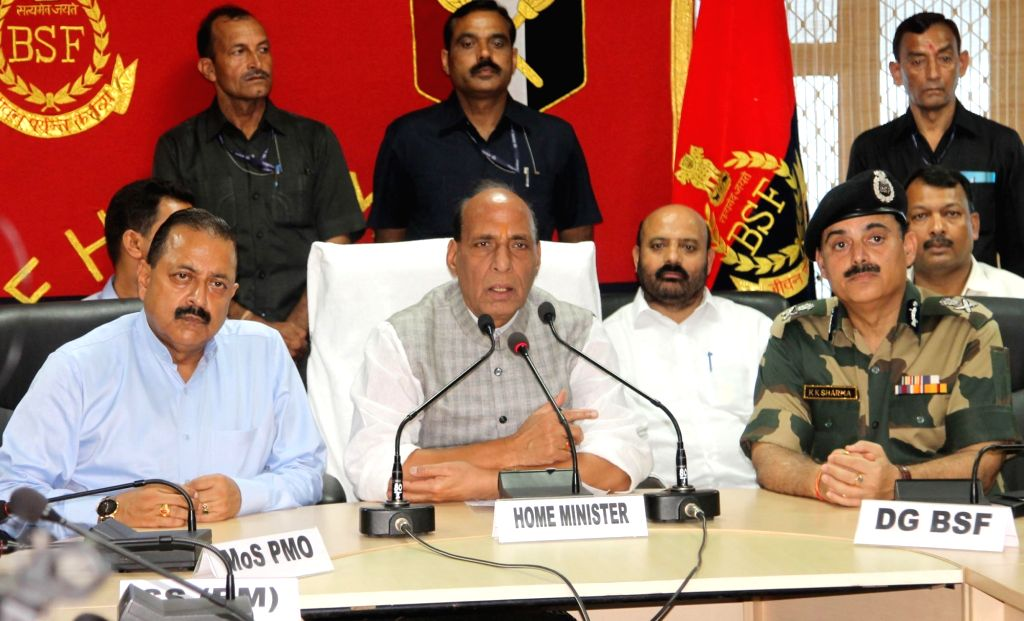 :Jammu: Union Home Minister Rajnath Singh addresses a press conference with Union MoS PMO Jitender Singh and BSF DG K. K. Sharma in Jammu on Sept 17, 2018. (Photo: IANS).