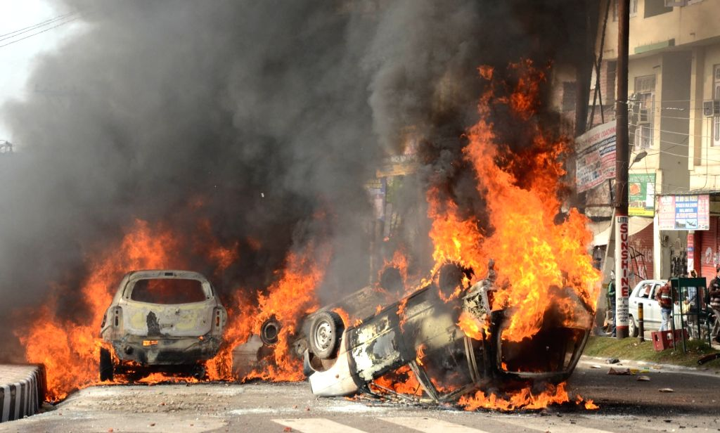 Jammu: Vehicles set ablaze by an irate mob protesting against militant attack on a CRPF bus in Jammu and Kashmir's Pulwama district in which 45 soldiers lost their lives; in Jammu on Feb 15, 2019. (Photo: IANS)