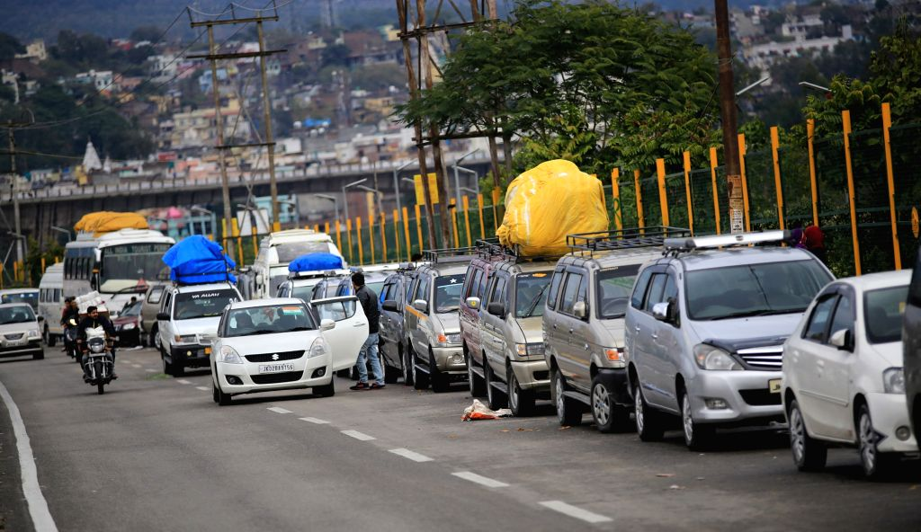Jammu: Vehicles stranded on Jammu-Srinagar national highway that remained closed for the fourth consecutive day as authorities said landslide clearance work is still in progress, in Jammu on Feb 15, 2018. Jammu-Srinagar highway remains closed. At lea