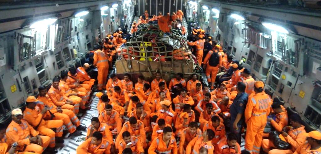 Jamnagar: NDRF personnel on board IAF C-17 aircraft that landed at Jamnagar, Gujarat on Jun 12, 2019. The NDRF team will carry out Humanitarian Assistance And Disaster Relief (HADR) missions in Gujarat, for the people affected by Cyclone Vayu. (Photo