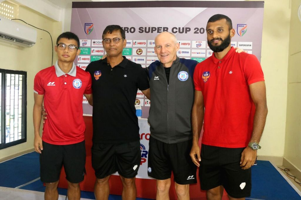 Jamshedpur FC's Steve Coppell and Jerry Mawihmingthanga with FC Goa's Derrick Pereira and Pronay Halder during a press conference ahead of a match between the two teams, in Bhubaneswar ...