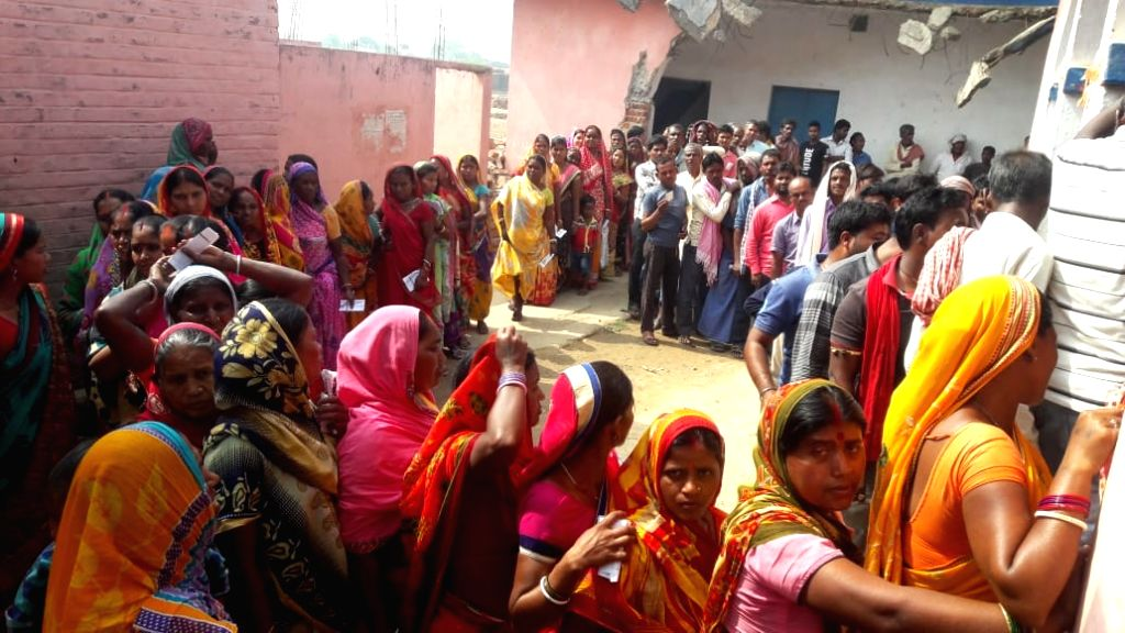 Jamui: People stand in queue to cast vote for Lok Sabha election at a polling station, in Bihar's Jamui, on April 11, 2019. (Photo: IANS)