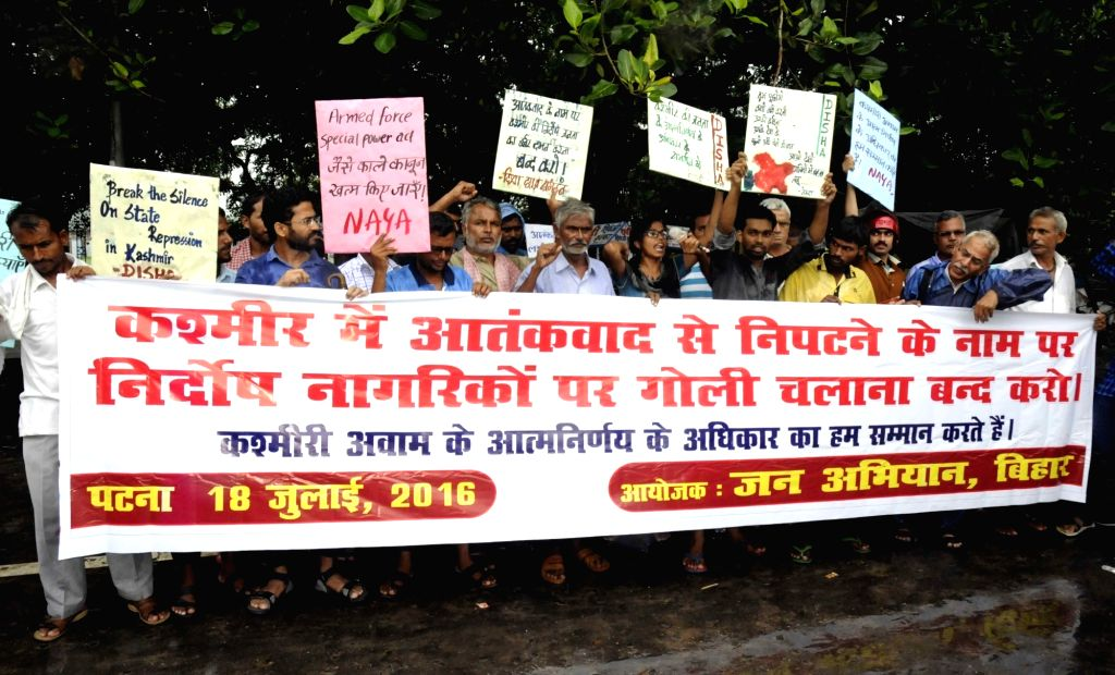 Jan Abhiyan activists participate in a protest rally against ongoing Kashmir violence in Patna on July 18, 2016.