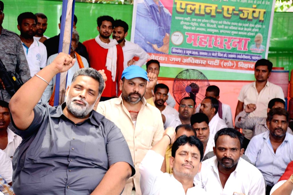 Jan Adhikar Party chief Pappu Yadav along with party workers stage a sit-in demonstration to press for their various demands, in Patna on June 5, 2018. - Pappu Yadav