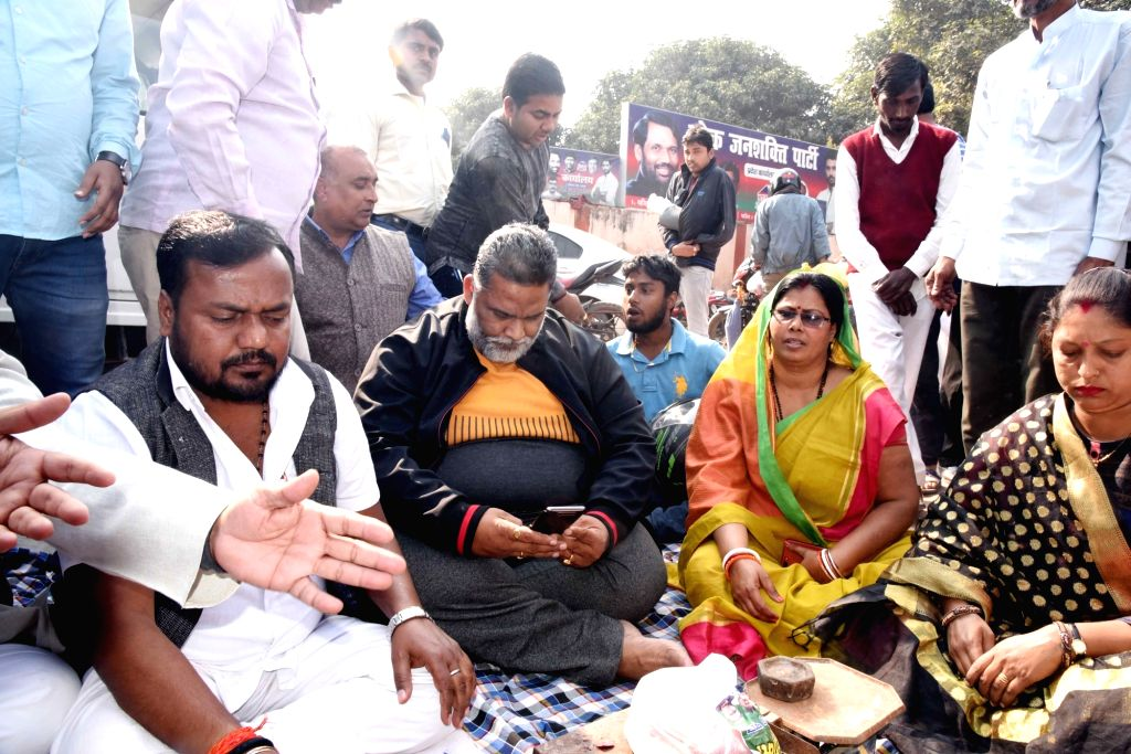 Jan Adhikar Party chief Pappu Yadav sells onions at Rs 35 a Kg outside the office of Lok Janshakti Party in Patna on Dec 6, 2019. Onion prices in the country are on a surge with the highest ... - Pappu Yadav