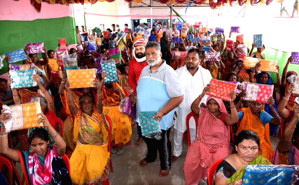 Jan Adhikar Party (JAP) chief Pappu Yadav distributes sarees among women on the occasion of the 74th Independence Day, in Patna on Aug 15, 2020. - Pappu Yadav