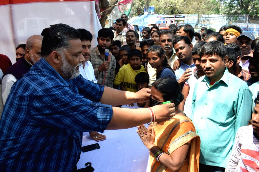 Jan Adhikar Party (JAP) chief Pappu Yadav distributes masks and soaps among people amid COVID-19 (coronavirus) pandemic, in Patna on March 20, 2020. - Pappu Yadav