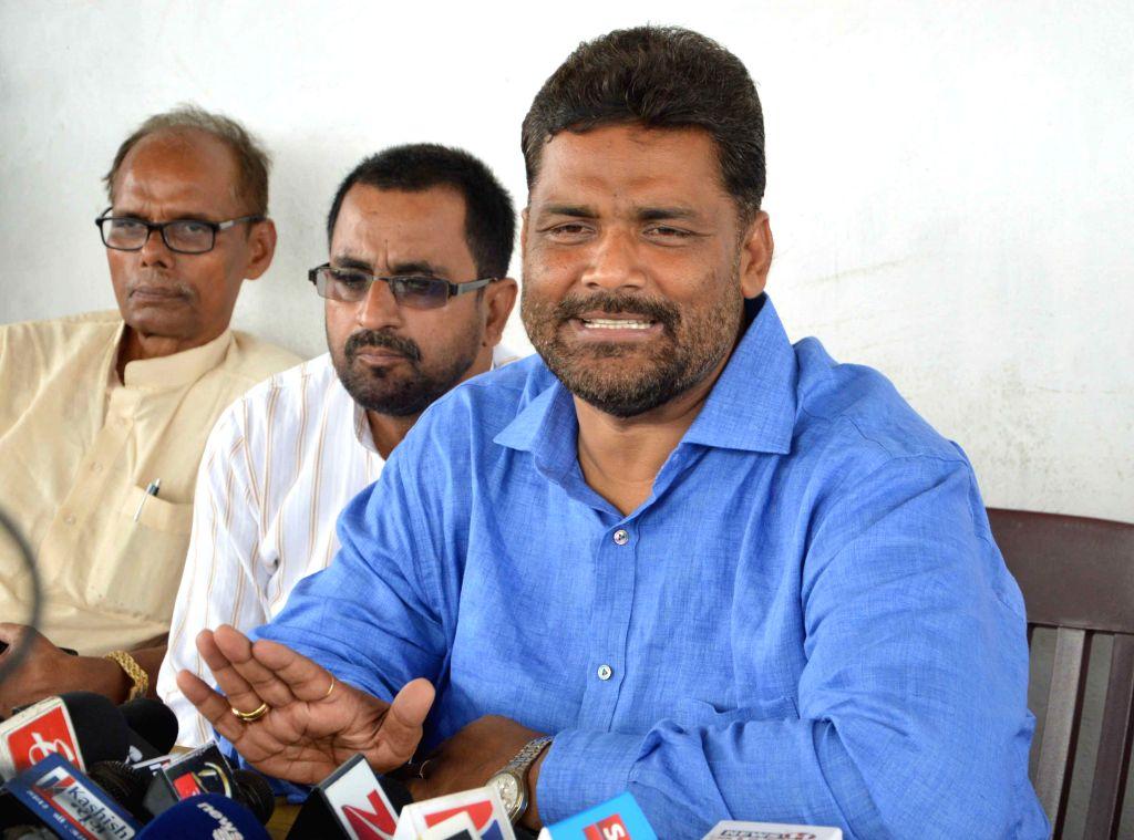 Jan Adhikar Party (JAP) founder Rajesh Ranjan alias Pappu Yadav addresses a press conference in Patna, on Aug 18, 2015. - Pappu Yadav