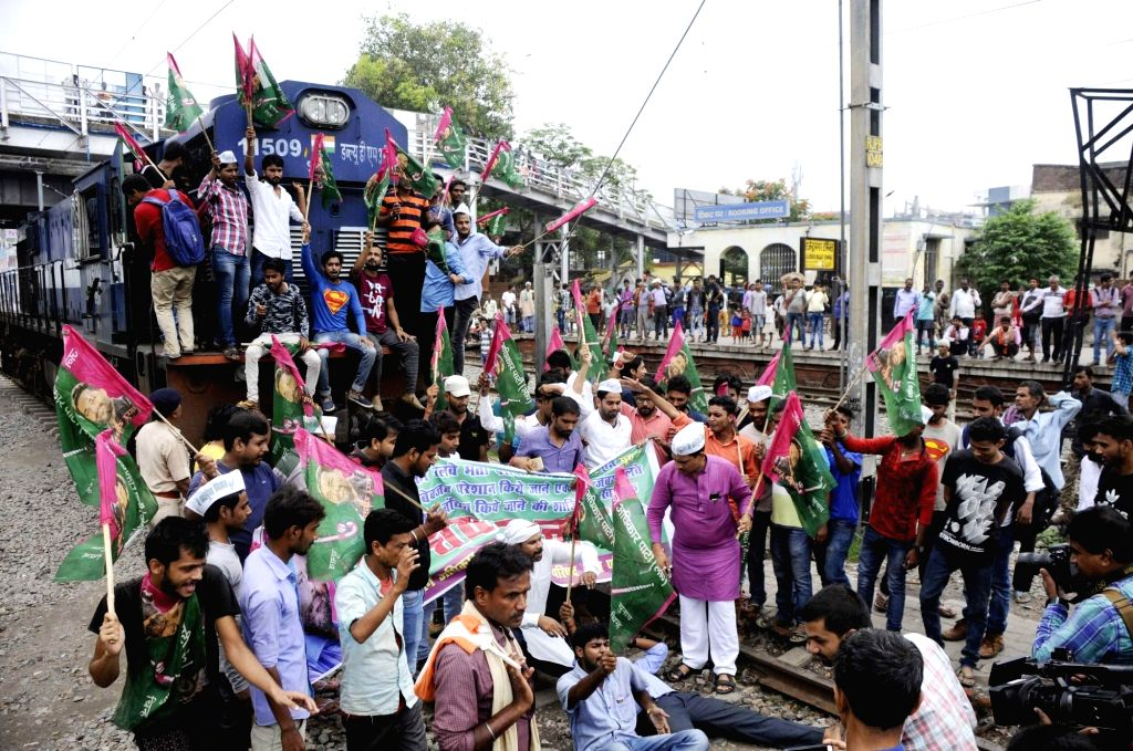 Jan Adhikar Party (JAP) workers block railway tracks at Rajendra Nagar Railway Station as they stage a demonstration over change in format of question paper in Railway recruitment  ...